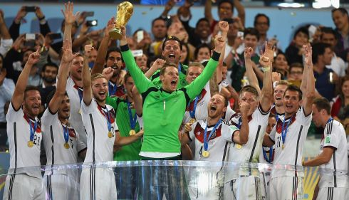 Manuel Neuer of Germany lifts the World Cup trophy with his team after defeating Argentina 1-0 in extra time during the 2014 FIFA World Cup Brazil Final match between Germany and Argentina at Maracana yesterday in Rio de Janeiro, Brazil. Photograph: Laurence Griffiths/Getty Images