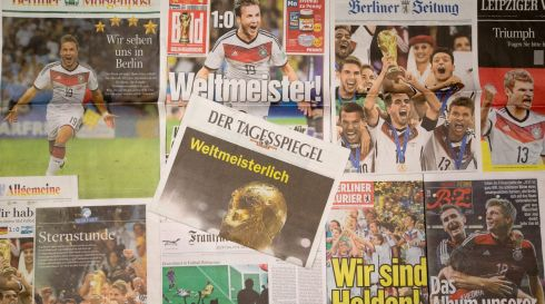 The front pages of German newspapers adorned with stories of the victory of the German team in the FIFA World Cup 2014 final match against Argentina. Photograph: Kay Nietfeld/EPA