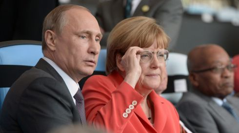 Russian President Vladimir Putin (L) and German Chancellor Angela Merkel (R) watch the FIFA World Cup 2014 final. Photograph: Alexey Nikolsky/ Ria Novosti/EPA