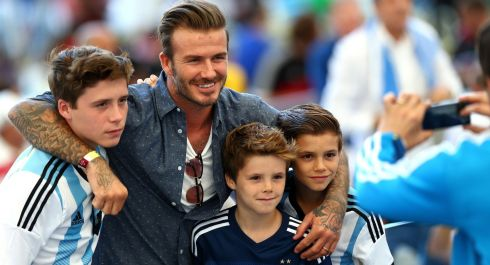 Former England international David Beckham and sons Brooklyn Beckham (L), Cruz Beckham (2nd R) and Romeo Beckham (R) at the 2014 FIFA World Cup Brazil Final. Photograph: Michael Steele/Getty Images