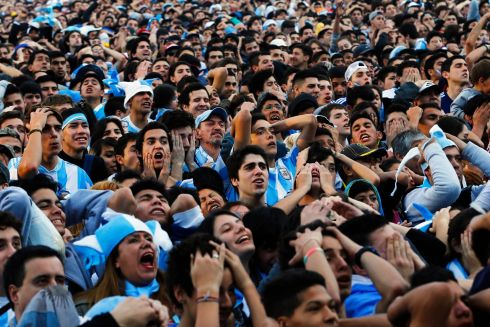 Argentina fans react as they watch a broadcast of the 2014 World Cup final soccer match between Germany and Argentina at a public square viewing area in Buenos Aires.  Photograph: Ivan Alvarado/Reuters