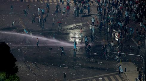 Police use a water canon and fire tear gas at Argentine soccer fans that turned violent near the Obelisco de Buenos Aires after their team lost to Germany 1-0 during the World Cup final on July 13, 2014 in Buenos Aires, Argentina. Photograph: Joe Raedle/Getty Images