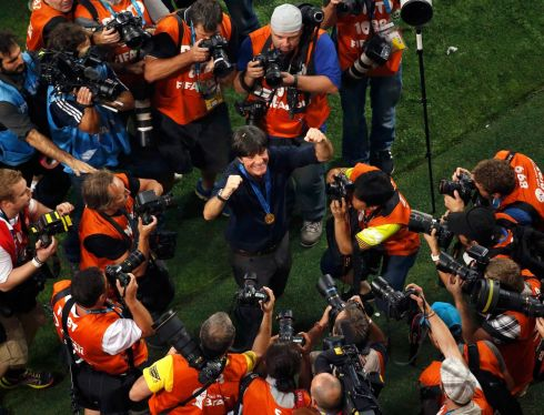 Photographers take pictures of Germany's coach Joachim Loew as he celebrates Germany's win against Argentina at the Maracana stadium in Rio de Janeiro. Photograph: Fabrizio Bensch/Reuters