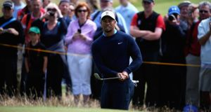 Tiger Woods  chips onto the sixth green during a practice round ahead of the 143rd British Open Championship at Royal Liverpool  in Hoylake, England. Photograph:  Matthew Lewis/Getty Images