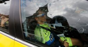 Alberto Contador of Spain sits in a  Saxo Tinkoff procycling team  car after crashing out  of the Tour de France on stage 10  from Mulhouse to La Planche des Belles Filles. Photograph: Kim Ludbrook/EPA