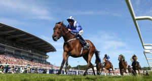 Paul Hanagan rides  Taghrooda to take the the Investec Oaks at Epsom in June, Photograph:  Charlie Crowhurst/Getty Images
