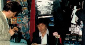 Patsy McGarry of Capital Radio at a book signing with the late James Herbert in 1989