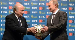 Russia's President Vladimir Putin and FIFA President Sepp Blatter take part in the official hand over ceremony for the 2018 World Cup scheduled to take place in Russia. Photograph: Alexey Nikolsky/Reuters