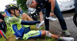 Tinkoff-Saxo team rider Alberto Contador of Spain gets medical assistance after he fell and broke his leg. Photograph: Jean-Paul Pelissier