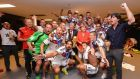 Germany's players and head coach Joachim Löw celebrate in their dressing room with Chancellor Angela Merkel following their victory in the World Cup final on Sunday night. Photograph: Lars Baron/Fifa/Getty Images.