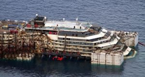 The wreck of the Costa Concordia cruise ship is prepared to be towed away near the port of Giglio in Italy yesterday. Photograph: EPA/Claudio Giovannini