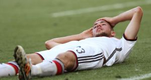 Christoph Kramer of Germany lies dazed on the pitch during the  World Cup final but got up and continued to play for a further 13 minutes before finally coming off. Photograph: EPA.