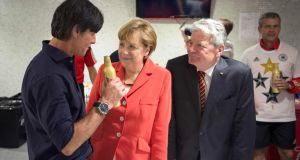 Germany football coach Joachim Löw talks to German chancellor Angela Merkel and president Joachim Gauck after the World Cup final victory over Argentina in Rio. Photograph: Guido Bergmann/Reuters/via Bundesregierung