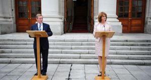 Taoiseach Enda Kenny and Tánaiste Joan Burton picturted after their first joint press conference outside government buildings last week. Photograph: Aidan Crawley