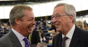 Nigel Farage (left), British Member of the European parliament and leader of the UK Independence Party (UKIP), greets Jean-Claude Juncker, candidate for President of the Commission, before his statement during the plenary session in the European Parliament in Strasbourg, France. Photograph: Patrick Seeger/EPA