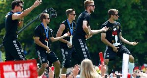 Germany players Mats Hummels, Philipp Lahm, Erik Durm, Benedikt Höwedes and Thomas Müller  play air guitar on  stage during celebrations to mark the team's 2014  World Cup victory in berlin. Photograph: Thomas Peter/Reuters