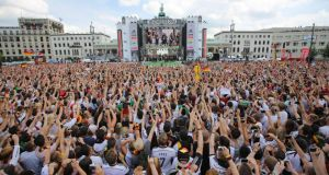 Fans cheer and celebrate as they wait for the arrival of the Germany's national soccer squad at the welcome reception in front of the Brandenburg Gate in Berlin. Photograph: Michael Kappeler/EPA