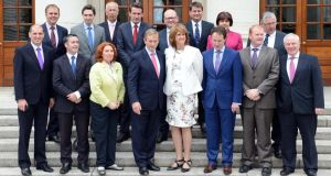 Taoiseach Enda Kenny and Tánaiste Joan Burton on the steps of Government Buildings today with new Ministers of State (back row, from left): Joe McHugh, Simon Harris, Kevin Humphries, Aodhán O'Riordán, Ged Nash, Dara Murphy, Ann Phelin, Tom Hayes, and (front row from left) Paul Kehoe, Damien English, Kathleen Lynch, Sean Sherlock, Paudie Coffey and Michael Ring. Photograph: Eric Luke/The Irish Times