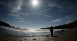 Julia Ormonde looking at an almost full moon in Kerry. Photograph: Michael Sheehan