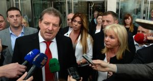 Steve Collins, with his family including his wife Carmel, son Steve jnr and daughter Leanne,  outside the Special Criminal Court in Dublin.  Photograph:  Dara Mac Dónaill/The Irish Times