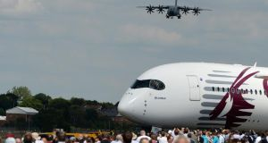An Airbus 400M comes into land with an Airbus 350 in the foreground, at Farnborough Airshow in southeast England yesterday.  Photograph: Andy Rain/EPA