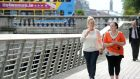 Danny Talbot's aunts Donna (left) and Deborah Lamb in Dublin yesterday. Every week the sisters come to Dublin's Liffey boardwalk in search of vulnerable young people to help. Photograph: Dara Mac Dónaill/The Irish Times