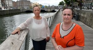 Donna (left) and Deborah Lamb, from Rathfarnham, Dublin, on the Liffey boardwalk at Eden Quay, Dublin, where they talk to vulnerable young people, similar in many ways  to their late nephew Danny Talbot. Photograph; Dara Mac Dónaill
