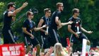 German players Mats Hummels, Philipp Lahm, Erik Durm, Benedikt Hoewedes and Thomas Mueller (L-R) play air guitar during celebrations in Berlin to mark the team's World Cup victory. Photograph: Reuters/Thomas Peter