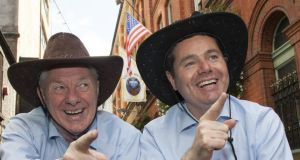 Ministers for Silly Hats: Paschal Donohoe and Michael Ring get ready for a hoedown. Photograph: Fáilte Ireland