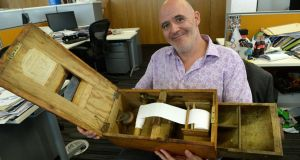 Conor Pope with his 'old but perfectly functioning cash box, which would have been common before cash registers'. Photograph: Cyril Byrne