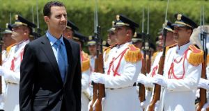 Bashar al-Assad reviews the guard of honour on his arrival at his swearing in ceremony at the presidential palace in Damascus on Wednesday. He was elected for another seven-year term with 88.7 per cent of the vote in an election in June. Photograph: EPA/Sana