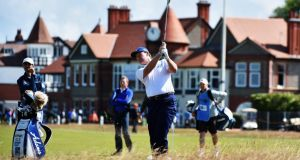 Ernie Els, watched by caddie Colin Byrne,   hits an approach shot during his practice round yesterday prior to the  143rd British Open at Royal Liverpool  in Hoylake. Photograph:  Warren Little/R&A/R&A via Getty Images