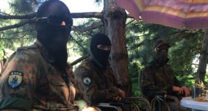 "Mikola, ""Lemko"" and Severin, three foreign volunteers fighting with the Azov Battalion.  Photograph: Daniel McLaughlin"