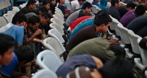 Guatemalan illegal immigrants deported from the US wait to be processed on their return to Guatemala City this week. Photograph: Reuters
