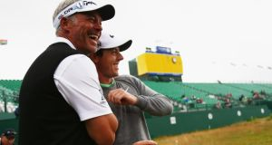 Darren Clarke and  Rory McIlroy have a laugh  after their practice round yesterday before the 143rd Open Championship tees off today at Royal Liverpool. Photograph:  Matthew Lewis/Getty Images)