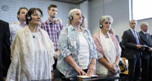 Bosnian women of the Srebrenica Mothers' Association listen to the announcement that the Dutch state was responsible for the deaths of more than 300 Srebrenica victims in a court ruling in The Hague yesterday. Photograph: Bart Maat/EPA