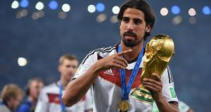 World Cup winner Sami Khedira of Germany celebrates with the trophy.  Sources in Spain claiming Real Madrid are ready to sell the midfielder for around £25 million. Photograph: Getty Images