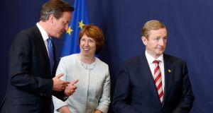 Taoiseach Enda Kenny with British prime minister David Cameron and  EU foreign policy chief Catherine Ashton at the  summit in Brussels yesterday. Photograph: Pascal Rossignol/Reuters