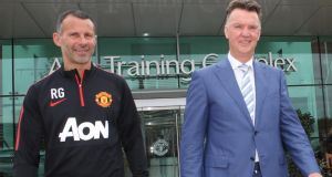 New Manchester United manager Louis van Gaal and  assistant manager Ryan Giggs  at the club's  Carrington training complex yesterday. Photograph:  John Peters/Man Utd via Getty Images