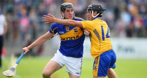 Tipperary's Dan McCormack and Clare's David Reidy during their Munster hurling under-21 semi-final at Cusack Park, Ennis, Co Clare. Photograph: Inpho