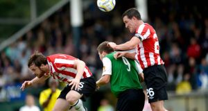 Ryan McBride and Cliff Byrne of Derry City in action against  Aberystwyth Town last week. Photograph: Huw Evans/Inpho.