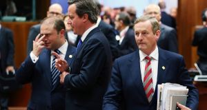 Malta's prime minister Joseph Muscat listens to Britain's prime minister David Cameron as Taoiseach Enda Kenny walks past during the European Union summit in Brussels yesterday. Photograph: Francois Lenoir/Reuters