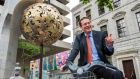 On yer bike: the IMF's Peter Breuer leaves the Central Bank after his last day there. Photograph: Brenda Fitzsimons