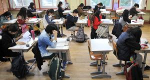 South Korean students prepare to take an exam. Photograph: Jung Yeon-Je/AFP/Getty Images