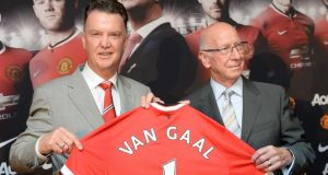 Manchester United manager Louis van Gaal and club ambassador Bobby Charlton during a photocall at Old Trafford, Manchester. Photograph:  Martin Rickett / PA Wire