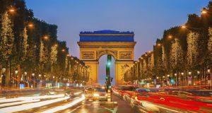 Traffic approaching the Arc de  Triomphe at night