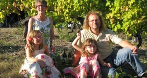 Caro and Seán Feely with their children, Sophia and Ellie, on their vineyard in France