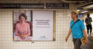 An ad for AirBnB in a New York Subway station. Photograph: Andrew Renneisen/New York Times