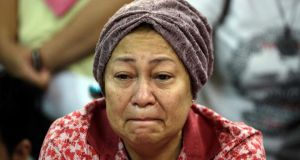A relative of a person on the crashed Malaysia Airlines flight cries at Kuala Lumpur International Airport yesterday. Photograph: Ahmad Yusni/EPA