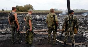 Pro-Russian separatists stand at the site of a Malaysia Airlines Boeing 777 crash near the settlement of Grabovo in the Donetsk region of Ukraine yesterday. Photograph: Maxim Zmeyev/Reuters